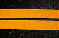 Black asphalt w  yellow striping.