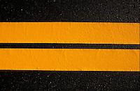 Black asphalt w  yellow striping.