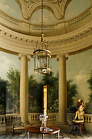 The rotunda walls are painted with flowers, fountains and woodland groves between trompe l'oeil columns and the room is furnished with Etruscan-style mahogany seats