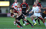 Ulster wing Andrew Trimble is quick to pounce on Dragons full back Dan Evans.<br /> RaboDirect Pro 12<br /> Newport Gwent Dragons v Ulster<br /> Rodney Parade<br /> 06.09.13<br /> <br /> ©Steve Pope-SPORTINGWALES