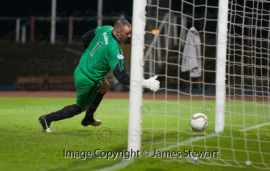 Forfar keeper Rab Douglas fumbles Dundee's Kevin McBride shot and lets the ball drop into the back of the net for Dundee's first.
