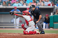 Chattanooga Lookouts catcher Chuckie Robinson (25) frames a pitch as home plate umpire Robert Nunez looks on during the game against the Tennessee Smokies at Smokies Stadium on July 31, 2021, in Kodak, Tennessee. (Brian Westerholt/Four Seam Images)