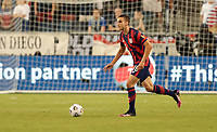 KANSAS CITY, KS - JULY 15: James Sands #16 of the United States looks for an open man downfield during a game between Martinique and USMNT at Children's Mercy Park on July 15, 2021 in Kansas City, Kansas.