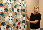 WASHINGTON, CT - 28 August 2012-082812EC09--     Country Life use.  Gail Scribner is a junior librarian with Gunn Library in Washington.  The libray is observing the Civil War with a quilt. Children decorated the squares with a fabric marker, senior citizens stitched them together.  Erin Covey Republican American.
