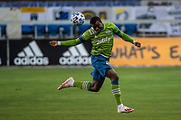 SAN JOSE, CA - OCTOBER 18: Nouhou Tolo #5 of the Seattle Sounders  heads the ball during a game between Seattle Sounders FC and San Jose Earthquakes at Earthquakes Stadium on October 18, 2020 in San Jose, California.