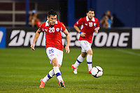 Charles Aranguiz (20) of Chile passes the ball. Ecuador defeated Chile 3-0 during an international friendly at Citi Field in Flushing, NY, on August 15, 2012.