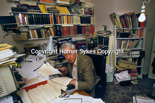 Hugh Peskett genealogist at home in his office  Winchester England. 1980s UK