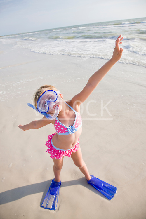 USA, Florida, St. Pete Beach, Portrait of girl (8-9) in diving equipment on beach