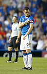 Jon Daly adjusts his captain's armband