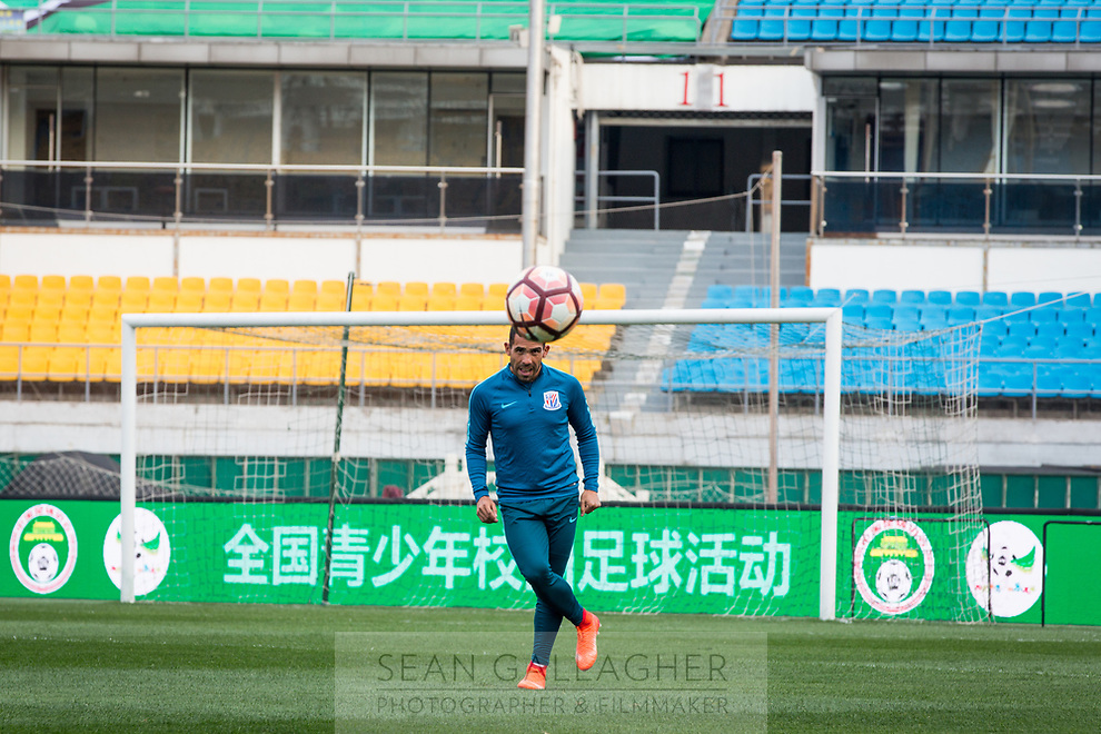 Carlos Tevez of Chinese Super League team Shanghai Shenhua practices before a game with Beijing Guo'an at the Worker's stadium in Beijing. 1st April, 2017.