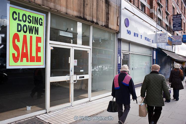 Closed down shops on Kilburn High Road.