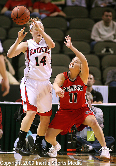 SIOUX CITY, IA - MARCH 14, 2009 --  Sara Haverdink #11 of Davenport University taps the ball away from Becca Hurley #14 of Northwestern College during their 2009 NAIA DII Women's Basketball National Championship quarterfinal game Saturday at the Tyson Events Center in Sioux City. (Photo by Dick Carlson/Inertia)