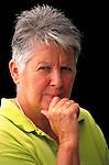 portrait of skeptical elder woman