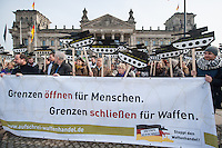 """Mit Panzerattrappen machte u.a. die Organisationen Pax Christi, die Kampagne """"Aufschrei"""" und die Deutsch Friedensgesellschaft (DFG-VK) am Mittwoch, den 26. Februar 2014 auf der Wiese vor dem Deutschen Bundestag auf den """"Skandal deutscher Ruestungsexporte"""" aufmerksam. """"Wir erinnern die Abgeordneten des Deutschen Bundestages an ihre Verantwortung für die toedlichen Folgen des Waffenhandels aus Deutschland"""" so die Veranstalter. Die Kundgebungsteilnehmer hielten  Schilder mit Panzerattrappen mit der Aufschrift """"Legt den Leo an die Kette!"""".<br />26.2.2014, Berlin<br />Copyright: Christian-ditsch.de<br />[Inhaltsveraendernde Manipulation des Fotos nur nach ausdruecklicher Genehmigung des Fotografen. Vereinbarungen ueber Abtretung von Persoenlichkeitsrechten/Model Release der abgebildeten Person/Personen liegen nicht vor. NO MODEL RELEASE! Don't publish without copyright Christian-Ditsch.de, Veroeffentlichung nur mit Fotografennennung, sowie gegen Honorar, MwSt. und Beleg. Konto:, I N G - D i B a, IBAN DE58500105175400192269, BIC INGDDEFFXXX, Kontakt: post@christian-ditsch.de<br />Urhebervermerk wird gemaess Paragraph 13 UHG verlangt.]"""
