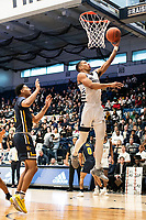 WASHINGTON, DC - FEBRUARY 22: Scott Spencer #2 of La Salle watches a shot by Armel Potter #2 of George Washington during a game between La Salle and George Washington at Charles E Smith Center on February 22, 2020 in Washington, DC.