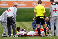 Nicholas Powell (C) of England receive medical help before being stretchered off during the UEFA U-17 championship Group A match between Serbia and England on May 9, 2011 in Indjija, Serbia (Photo by Srdjan Stevanovic/Starsportphoto.com)
