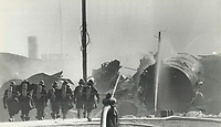 1979 FILE PHOTO - ARCHIVES -<br /> <br /> Three-day battle: A crew of firemen - some of the 288 who have been fighting the Mississauga railcar blaze for three days - move up on the smoking debris to inspect the automatic hoses trained on the leaking chlorine tank to keep it cool. Many said they were worried more about further explosions than the leaking chlorine gas.<br /> <br /> Bezant, Graham<br /> Picture, 1979, <br /> <br /> 1979,<br /> <br /> PHOTO : Graham Bezant - Toronto Star Archives - AQP