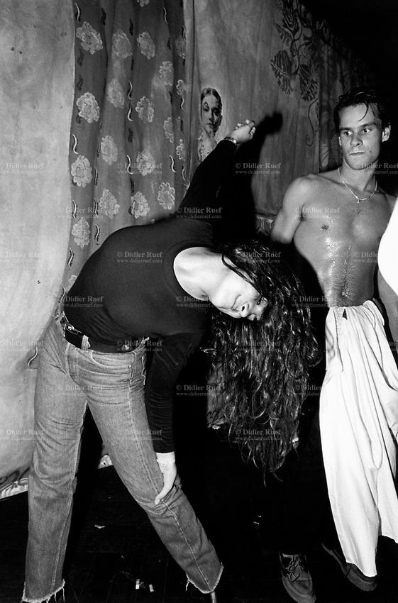 Switzerland. Geneva. Theatre Pittoëf. Satori Bar. A couple dances at night on the beat of techno music. © 1994 Didier Ruef