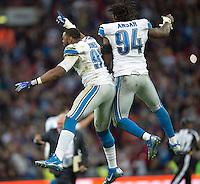 26.10.2014.  London, England.  NFL International Series. Atlanta Falcons versus Detroit Lions. Lions' DE Ezekie lAnsah [94] and Lions' DE Jason Jones [91] celebrate the win over Atlanta.