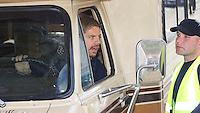 Cardonald - Glasgow, Scotland. Brad Pitt body double asks for directions as he takes the sets Jamboree motorhome for a spin of the set during filming on the super market set in Cardonald of World War Z in Glasgow..Picture: Maurice McDonald/Universal News And Sport (Scotland). 20 August 2011. www.unpixs.com..