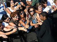 """Actor Denzel Washington greets people during a pohotocall to promote his film """"The Equalizer"""" during the 62nd San Sebastian Film Festival on September 19, 2014, Basque country. (Ander Gillenea / Bostok Photo)"""