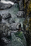 Dramatic aerial scenery of shiny rocky river banks and rapids of the Englishman River at Englishman River Falls Provincial Park. Errington, Vancouver Island, BC, Canada Image © MaximImages, License at https://www.maximimages.com