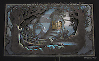 The pop-up scenes varied from very complex constructions, to simpler three or four layer scenes like this. The rods at bottom controlled the door and Gargamel.