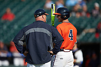 Virginia Cavaliers associate head coach Kevin McMullan talks with Ernie Clement (4) during the game against the Duke Blue Devils in Game Seven of the 2017 ACC Baseball Championship at Louisville Slugger Field on May 25, 2017 in Louisville, Kentucky. The Blue Devils defeated the Cavaliers 4-3. (Brian Westerholt/Four Seam Images)