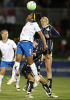 Homare Sawa#10 and Allie Long#9 of the Washington Freedom lose a header to Chioma Igwe#2 of the Boston Breakers during a WPS match on April 10 2010, at the Maryland Soccerplex, in Boyds, Maryland.
