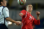 International Friendly match between Wales and Scotland at the new Cardiff City Stadium : Wales' Andy King takes on Scotlands' Lee Wallace.