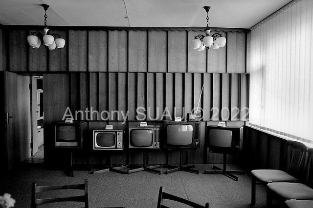 Lviv, Ukraine.August 1998.ELEKTRON, once one of the major producers of TV sets in the former Soviet Union, now assembles casings for Samsung TVs and cartons for Coca-Cola. In an office a display of old ex-Soviet TVs is on display along with resent models..