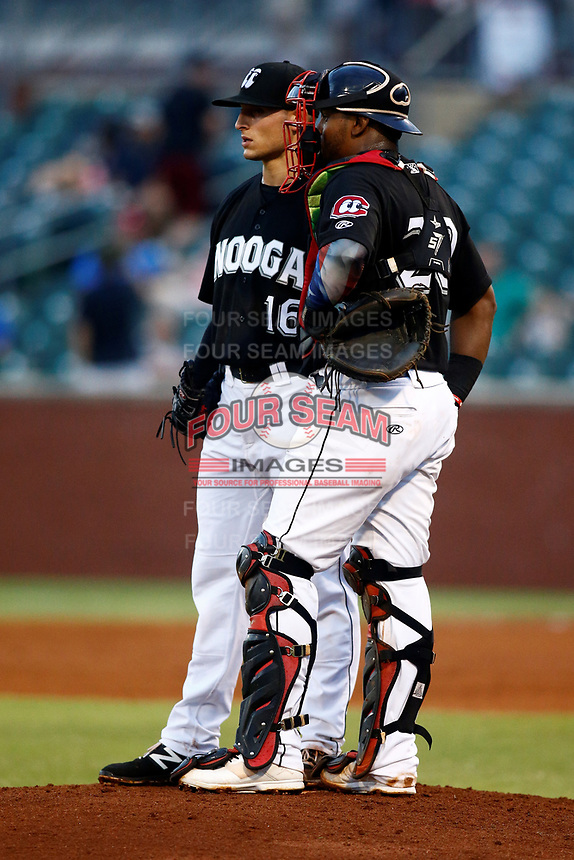 Chattanooga Lookouts Anthony pitcher Marzi (16) and catcher Brian Navarreto (20) talk strategy against the Montgomery Biscuits on May 26, 2018 at AT&T Field in Chattanooga, Tennessee. (Andy Mitchell/Four Seam Images)