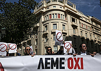 """Pictured: Taxi drivers holding """"Uber, No Thanks"""" and with a banner which reads """"We Say No"""" protest in Syntagma Square, Athens Greece. Tuesday 06 March 2018<br /> Re: Taxi drivers have attacked Uber vehicles while protesting against Uber operating in Athens, Greece.<br /> Taxi drivers will on strike for nine hours on Tuesday8 a.m. to 5 p.m. in protest at what they call unfair competition from Uber taxi services.<br /> In a statement, the SATA union representing cab drivers in Attica also expressed dismay at delays in passing a Transport Ministry bill to reorganize their sector and derided """"innovative platforms that rob taxi drivers and the country."""""""
