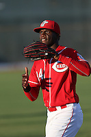 Michael Beltre (34) of the AZL Reds throws before a game against the AZL Brewers at Cincinnati Reds Spring Training Complex on July 5, 2015 in Goodyear, Arizona. Reds defeated the Brewers, 9-4. (Larry Goren/Four Seam Images)