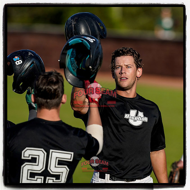 Julian Rip (34) of the USC Upstate Spartans Black team is greeted after hitting a home run in the Green and Black Fall World Series Game 3 on Sunday, November 1, 2020, at Cleveland S. Harley Park in Spartanburg, South Carolina. Green won, 3-2. (Tom Priddy/Four Seam Images)