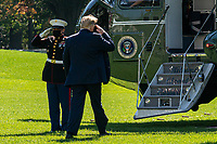 United States President Donald J. Trump salutes the Marine Guard as he boards Marine One on the South Lawn of the White House on Thursday, October 15, 2020. Trump will deliver remarks at a Fundraising Committee Reception in Doral, Florida and participate in a Live NBC News Town Hall Event.  <br /> CAP/MPI/RS<br /> ©RS/MPI/Capital Pictures