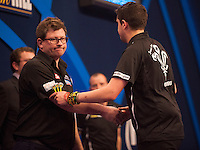 21.12.2014.  London, England.  William Hill World Darts Championship.  Jamie Lewis [WAL] congratulates James Wade (6) [ENG] following their match. Wade won the match 3-1