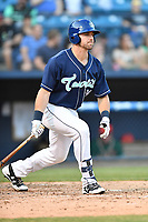 Asheville Tourists designated hitter Chad Spanberger (24) swings at a pitch during a game against the Greensboro Grasshoppers  at McCormick Field on May 10, 2018 in Asheville, North Carolina. The Tourists defeated the Grasshoppers 9-3. (Tony Farlow/Four Seam Images)