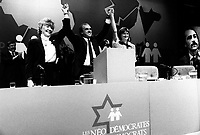 March 15, 1987  File Photo-  Marion Dewar (L) , Johanna Den Hertog (R) and Ed Broadbent, leader, Canada New Democratic Party (NDP) at the1987 convention  in Montreal.<br /> <br /> <br /> PHOTO :  Agence Quebec Presse