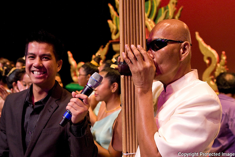 Mino Sundara and ajahn Bounseung Synanonh during the Lao Artists Festival in Elgin, IL, photographed on August 21, 2010.  (photo by Khampha Bouaphanh)