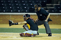USC Trojans catcher Blake Sabol (5) sets a target as home plate umpire Gary Swanson looks on during the game against the Wake Forest Demon Deacons at David F. Couch Ballpark on February 24, 2017 in  Winston-Salem, North Carolina.  The Demon Deacons defeated the Trojans 15-5.  (Brian Westerholt/Four Seam Images)