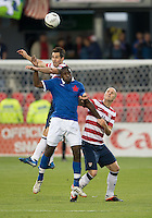 03 June 2012:US Men's National Soccer Team defender Carlos Bocanegra #3 and US Men's National Soccer Team midfielder Michael Bradley #4 battle for a ball during an international friendly  match between the United States Men's National Soccer Team and the Canadian Men's National Soccer Team at BMO Field in Toronto..The game ended in 0-0 draw...