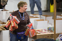 Volunteers sort and pack human food for the volunteers which will be working at the 20+ checkpoints durinig this year's 2016 Iditarod Race at the Airland Transport warehouse in Anchorage on Friday, February 19, 2016.