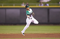 Dayton Dragons shortstop Jose Garcia (15) makes a throw to first base against the Bowling Green Hot Rods at Fifth Third Field on June 8, 2018 in Dayton, Ohio. The Hot Rods defeated the Dragons 11-4.  (Brian Westerholt/Four Seam Images)