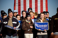 """Romney supporters gather behind Republican presidential candidate Mitt Romney, former governor of Massachusetts, as he speaks to the media during a rally in Manchester, New Hampshire, on Sat. Dec. 3, 2011. The rally was called, """"Earn It with Mitt,"""" and was designed to bolster local efforts to help Romney """"earn"""" voters' support for the upcoming Republican primary."""