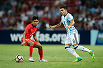 Marcos Acuna of Argentina (R) in action against Nazrul Nazari of Singapore (L) during the International Test match between Argentina and Singapore at National Stadium on June 13, 2017 in Singapore. Photo by Marcio Rodrigo Machado / Power Sport Images