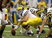 David Molk of Michigan in action during Sugar Bowl game against Virginia Tech at Mercedes-Benz SuperDome in New Orleans, Louisiana on January 3rd, 2012.  Michigan defeated Virginia Tech, 23-20 in first overtime.