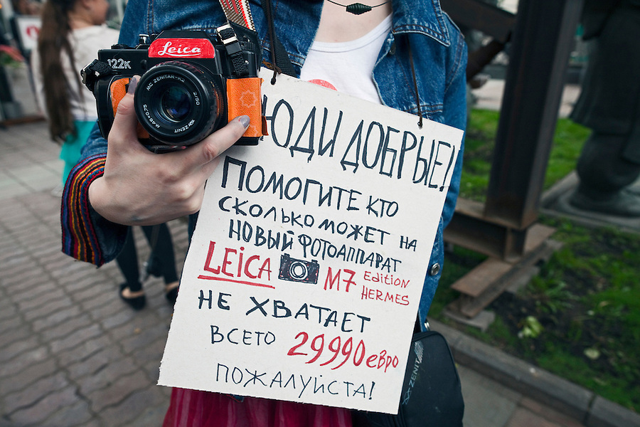 """Moscow, Russia, 19/05/2012..Several thousand artists and opposition activists demonstrate against Vladimir Putin by walking through Moscow transporting their artworks. The protest coincided with Museum Night, when Moscow's museums are open until midnight with special exhibitions and performances..""""Good people! Help me as much as you can for a new camera Leica M7 Hermes Edition. I don't have enough, it's only 29990 Euros, please!"""""""