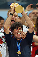 Germany manager Joachim Low lifts the World Cup trophy after winning the 2014 final