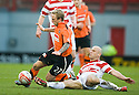 ::  DUNDEE UTD'S JOHNNY RUSSELL IS CHALLENGED BY HAMILTON'S SIMON MENSING ::